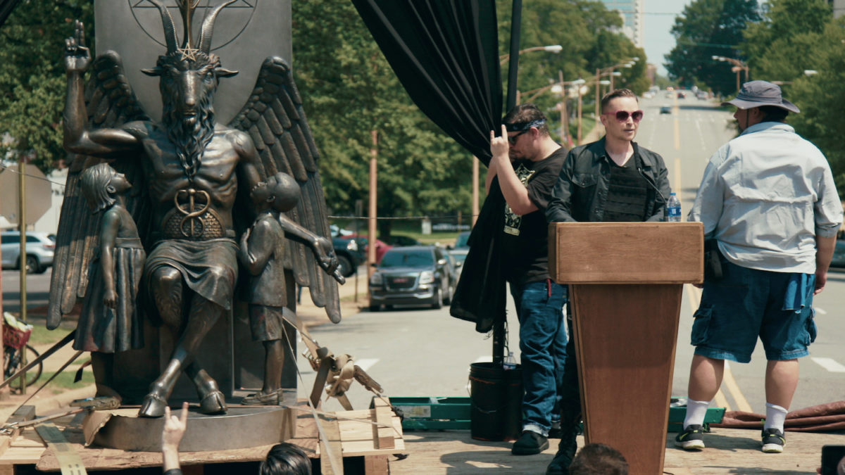 Lucien Greaves delivering a speech in front of the state capitol building in Little Rock