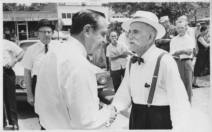 Gov. Orval Faubus greets a voter in Clinton in 1962.