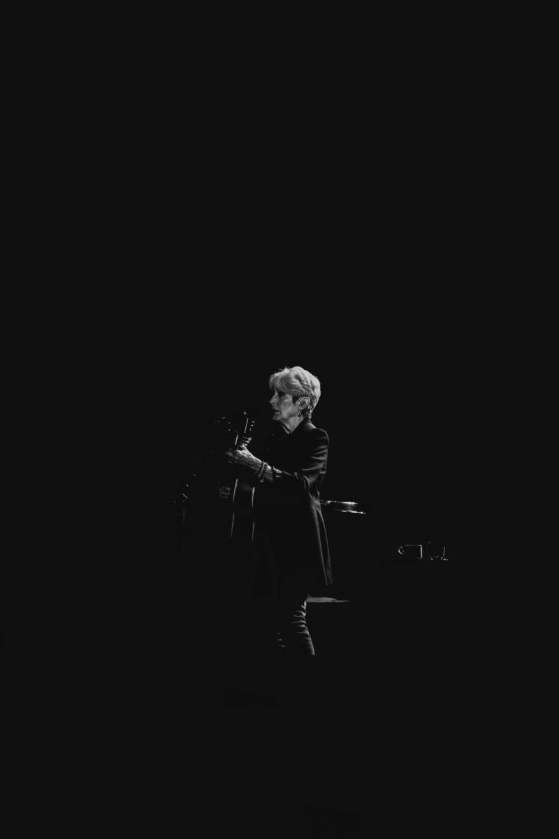 Joan Baez on stage in black and white