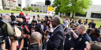 Little Rock Police Chief Keith Humphrey talks to protestors outside Little Rock City Hall