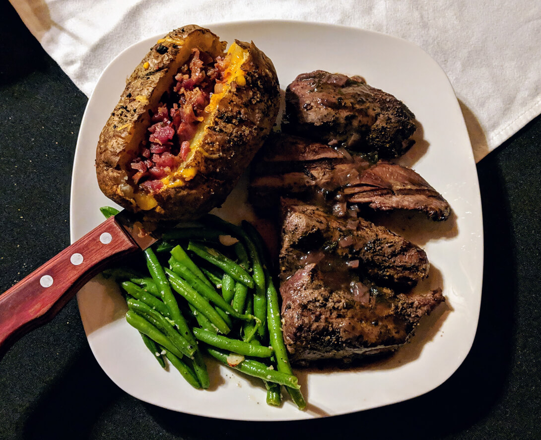 image of steak, baked potato and green beans from The Rock House in Talihina, Oklahoma