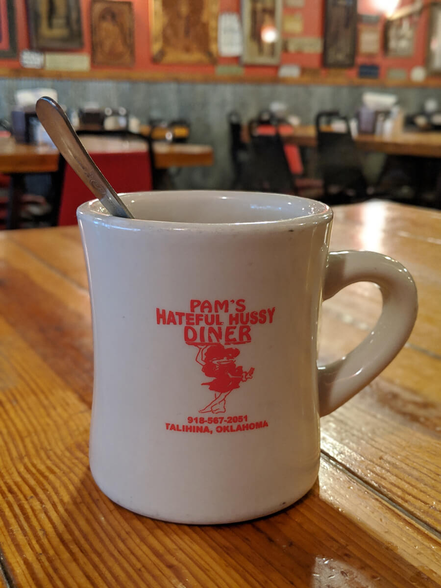 image of coffee cup at Pam's Hateful Hussy Dinner