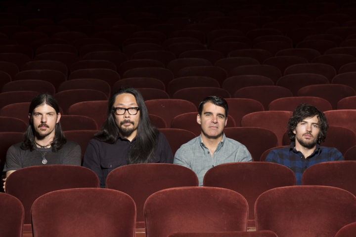 The Avett Brothers band, seated in a theater on red velvet chairs