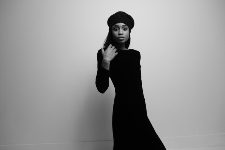 guitarist and songwriter Adia Victoria in beret and long black dress