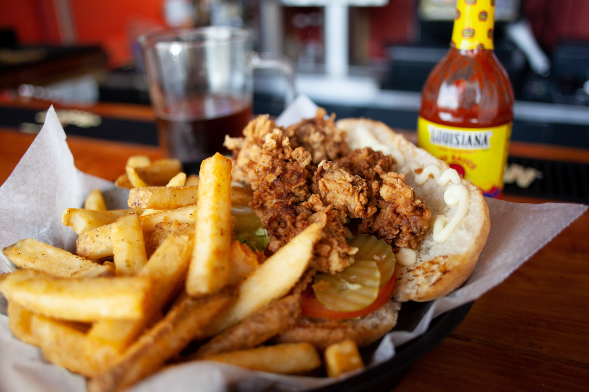 Picture of an oyster poboy and fries at The Capital Seafood House