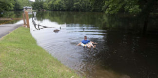 picture of Houston Brantley swimming in an inner tube near Pinnacle Mountain State Park.