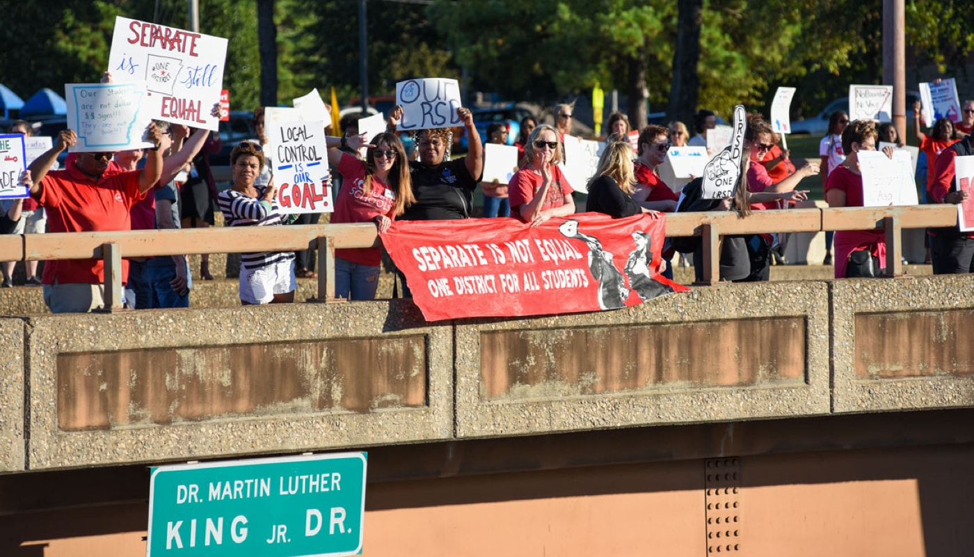 Teachers and community members gathered on Oct. 7 on an Interstate 630 overpass to demand local control.