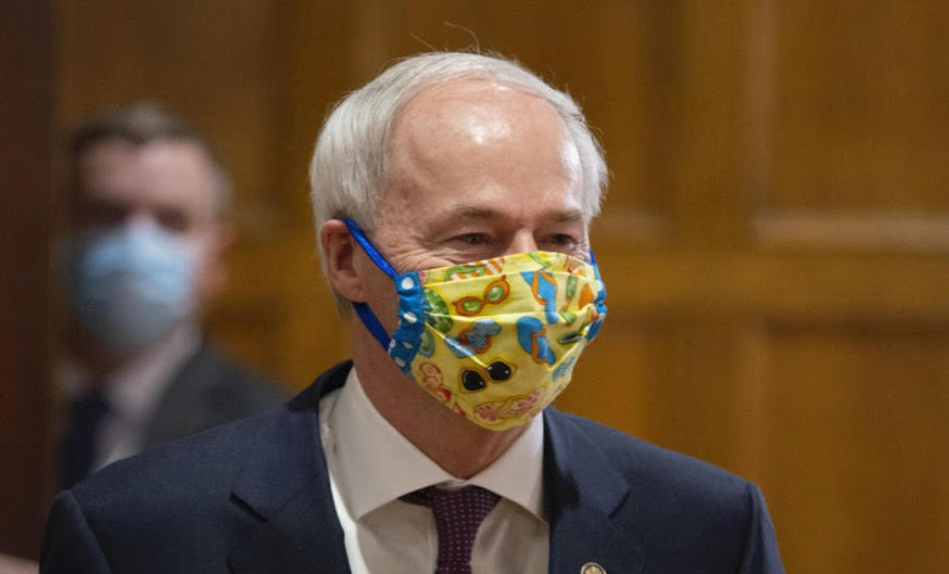 Mask pressure mounts and governor dodges, with deadly results particularly in Little Rock