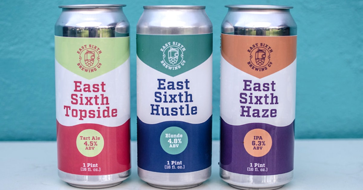 Three cans of East Sixth beer.