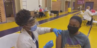teacher gets covid vaccine