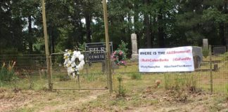 A picture of a banner at Files Cemetery in Hot Springs raises questions about who is buried there and why a memorial to AIDS victims isn't yet installed.